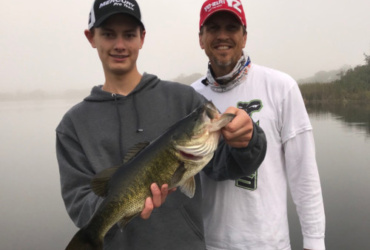 Teen son enjoys personal-best bass fishing during winter trip